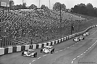 HAMPTON, GA - APRIL 22: Bobby Unser (#12 Penske/Cosworth TC) leads Wally Dallenbach (#40 Penske/Cosworth TC) and others during the Gould Twin Dixie 125 event on April 22, 1979, at Atlanta International Raceway near Hampton, Georgia.
