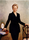 """Hillary Rodham Clinton was painted by Simmie Knox in 2003 from sittings in the Clinton home in Washington, D.C.  Her left hand rests on the back of an early-nineteenth-century armchair from the White House collection.  Her right hand touches a table exhibiting a service plate from the Clinton state china service; a copy of Mrs. Clinton's 1996 book, """"It Takes A Village: And Other Lessons Children Teach Us""""; and a piece from a hand-blown glass basket set by American artist Dale Chihuly.  These items symbolize the White House, Mrs. Clinton's work with children, and her involvement in the arts.  The portrait was unveiled at a ceremony the White House in Washington, D.C. on June 14, 2004.  .Credit: Ron Sachs / CNP"""