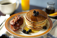 Pancake, Bacon and Berry Breakfast with Coffee and Juice