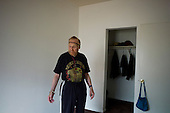 Los Angeles, California<br /> January 28, 2014<br /> <br /> Former WWII homeless veteran Ivan Bennett 85 yrs old in a home he moved into 5 days ago. He stands in his bedroom wit the few belongings that he has.
