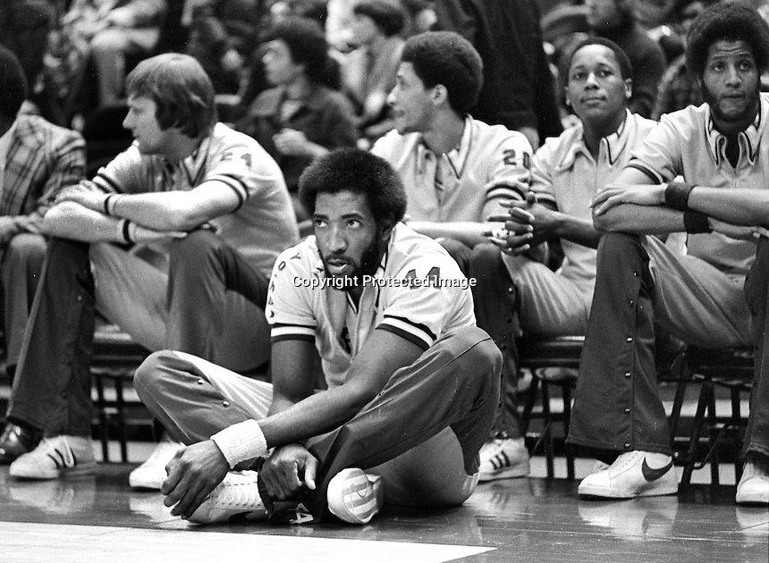 Golden State Warriors bench...Center Clifford Ray sitting, with Rick Barry, Phil Smith, Charles Dudley, Jamaal Wilkes. (1976 photo by Ron Riesterer)