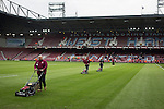 West Ham United 2 Crystal Palace 2, 02/04/2016. Boleyn Ground, Premier League. Groundsmen cutting the grass at the end of the match at the Boleyn Ground as West Ham United hosted Crystal Palace in a Barclays Premier League match. The Boleyn Ground at Upton Park was the club's home ground from 1904 until the end of the 2015-16 season when they moved into the Olympic Stadium, built for the 2012 London games, at nearby Stratford. The match ended in a 2-2 draw, watched by a near-capacity crowd of 34,857. Photo by Colin McPherson.