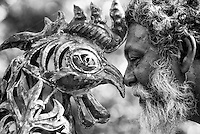Artist Laki Senanayake comes face to face with one of his sculptures. At his home, Diyabubula.