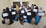 Women refugees from Syria graduating from a Start Your Business course display their diplomas in Zarqa, Jordan. The 15 day course was sponsored by the Department of Service for Palestinian Refugees of the Middle East Council of Churches, a member of the ACT Alliance. Refugees are not allowed to obtain formal employment in Jordan, but the women can run small businesses from their homes.