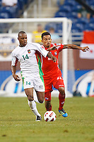 Guadeloupe midfielder Gregory Gendrey (14) and Panama midfielder Amilcar Henríquez (21) go for the ball during the CONCACAF soccer match between Panama and Guadeloupe at Ford Field Detroit, Michigan.