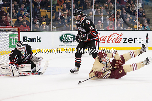 Patrick Brown (BC - 23) redirects the puck to give BC the lead. - The Boston College Eagles defeated the Northeastern University Huskies 4-1 (EN) on Monday, February 10, 2014, in the 2014 Beanpot Championship game at TD Garden in Boston, Massachusetts.