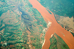 A rain swollen river carries silt from eroding hills, Madagascar