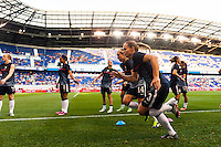 United States (USA) defender Christie Rampone (3) and defender Whitney Engen (14) during warmups. The women's national team of the United States defeated the Korea Republic 5-0 during an international friendly at Red Bull Arena in Harrison, NJ, on June 20, 2013.