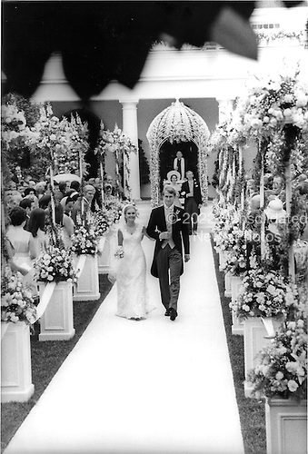 Washington, DC - June 12, 1971 -- United States President Richard M. Nixon's daughter, Tricia, left, was married on Saturday, June 12, 1971 in the Rose Garden of the White House in Washington, D.C. to Edward Cox, right.  The newlyweds are shown walking down the aisle after the ceremony..Credit: Pool via CNP