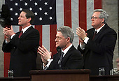 United States President Bill Clinton is joined by U.S. Vice President Al Gore, left, and Speaker of the House Dennis Hastert (Republican of Illinois), right, as he applauds Lyn Gibson and Wei Ling Chestnut, the widows of the two Capitol policeofficers who were killed in 1998 as he begins the State of the Union Address during a Joint Session of Congress in Washington, D.C. on January 19, 1999.                                                          .Credit: Win McNamee / Pool via CNP