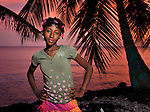 """Romage Jean Louis, a member of Nouvel Etwal - Haitian Kreyol for """"New Stars"""" - poses on the beach at Jacmel, Haiti. Nouvel Etwal is a dance and creative movement group of 16 girls from age 8 to 13, based in the southern village of Mizak. According to Valerie Mossman-Celestin, an organizer of the group, """"Nouvel Etwal seeks to empowers girls to be self-confident and creative. The girls learn flexibility, discipline and teamwork, lessons they also need for life. Nouvel Etwal promotes health, well-being and enhanced self-worth. The girls are encouraged to live into a brighter future where girls and women are valued,  educated, and have equal opportunity to achieve their potential."""""""
