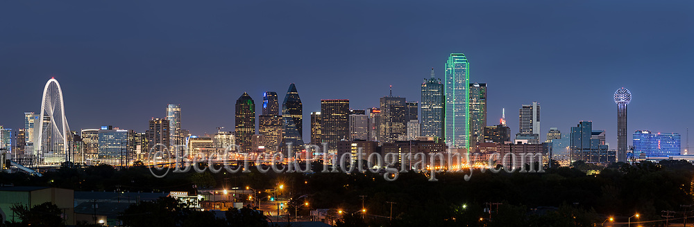 Dallas skyline panorama of the city at dusk with the Margaret Hunt Hill Bridge to the Reuion Tower and Omini hotel with all the usual high rise skyscrapers in the downtown area.