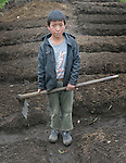 A boy pauses as school children prepare garden plots and plant vegetables in San Jose la Frontera, a small Mam-speaking Maya village in Comitancillo, Guatemala. The program is jointly sponsored by the community's school and the Maya Mam Association for Investigation and Development (AMMID).