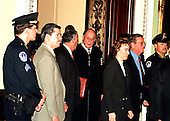 Chief Justice of the United States William Rehnquist leaves the U.S. Senate Chamber in the U.S. Capitol in Washington, D.C. following the Senate vote acquitting U.S. President Bill Clinton on February 12, 1999.  Also recognizable in the photo, from left, are U.S. Senators Paul Sarbanes (Democrat of Maryland), Mary Landrieu (Democrat of Louisiana), and Pete Domenici (Republican of New Mexico)..Credit: Ron Sachs / CNP