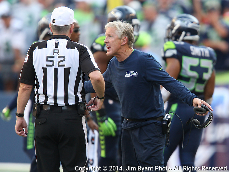 Seattle Seahawks head coach Pete Carroll argues a call with Referee Bill Vinovich (54) during the game against the  Denver Broncos at CenturyLink Field in Seattle, Washington on September 21, 2014. The Seahawks won 26-20 in overtime.    ©2014. Jim Bryant Photo. All rights Reserved.