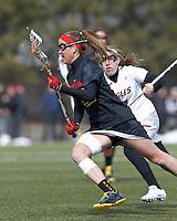 University of Maryland midfielder Beth Glaros (20) on the attack. .University of Maryland (black) defeated Boston College (white), 13-5, on the Newton Campus Lacrosse Field at Boston College, on March 16, 2013.