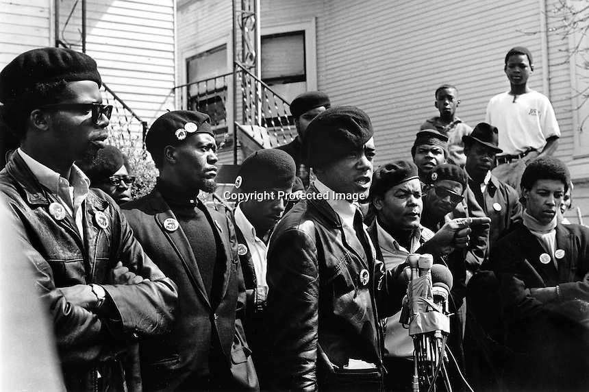 Black Panther press conference in Oakland, Ca  after the shooting of one of their members 17-year old Bobby Hutton. Hutton was shot by Oakland Police when he and Panther Elridge Cleaver were envolved in a shootout with police. (center)at microphones is  Bobby Seale, and to his left is William Lee Brent. (1968 photo by Ron Riesterer)<br />