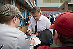 Burnley 1 West Ham United 3, 18/10/2014. Turf Moor, Premier League. Visiting manager Sam Allardyce signing an autograph outside The fixture was won by the visitors by three goals to one watched by 18,936 spectators. The defeat meant that Burnley still had not won a league match since being promoted from the Championship the previous season. Photo by Colin McPherson.
