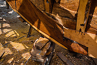 A wooden keel is seen during the construction process of a traditional fishing vessel in an artisanal shipyard on the beach in Manta, Ecuador, 14 September 2012. The construction process takes 3-4 months to complete, depending on the ship size and purpose (fish capture methods). Although a wooden boat tends to be more stable on the sea and less expensive to build (up to $0.5 million USD), it needs a maintenance every 2 years, while a fiberglass-made boat, costing almost double the wooden one, may serve 5-6 years without any repairs. The shipyard produces 6-8 vessels every year.