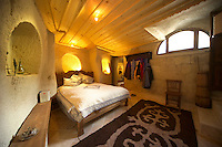 Goreme, Cappadocia, Turkey, July 2005. The guestroom is situated in the old donkey stables. Dutch Photographer Frits Meyst and his wife Jillian Macdonald restored an old rock house in the village of Goreme. Since Roman Times people have been cutting graves and home out of the Soft tufo 'Fairy Chimney' rocks of Cappadocia. Photo by Frits Meyst / MeystPhoto.com