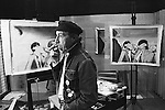 Richard Hamilton pop artist in his studio London UK 1968. Seen in studio with prints depicting Mick Jagger and Hamilton's art dealer Robert Fraser being arrested for possession of drugs. <br />