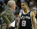 San Antonio Spurs guard Tony Parker of France, R, talks to Spurs Head Coach Gregg Popovich, L, during a time out called by the Seattle SuperSonics in the first period of their  Western Conference Semifinals Game 3 in Seattle, Washington on Tuesday, 12 May 2005..Jim Bryant Photo. &copy;2010. All Rights Reserved.