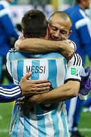 Javier Mascherano of Argentina celebrates victory with Lionel Messi