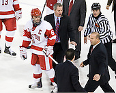 Joe Pereira (BU - 6), Mike Bavis (BU - Associate Head Coach), Sebastien Laplante (Northeastern - Assistant Coach), Greg Cronin (Northeastern - Head Coach), Bob Bernard - The visiting Northeastern University Huskies defeated the Boston University Terriers 5-4 on Sunday, March 13, 2011, to win their Hockey East Quarterfinal matchup 2 games to 1 at Agganis Arena in Boston, Massachusetts.