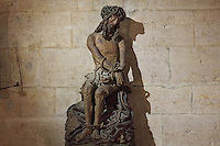 Passion of Christ, a late 15th century sculpture of Christ with hands and feet bound, wearing the crown of thorns, sculpted from one oak trunk, in the Salle des Povres or Room of the Poor, in Les Hospices de Beaune, or Hotel-Dieu de Beaune, a charitable almshouse and hospital for the poor, built 1443-57 by Flemish architect Jacques Wiscrer, and founded by Nicolas Rolin, chancellor of Burgundy, and his wife Guigone de Salins, in Beaune, Cote d'Or, Burgundy, France. The hospital was run by the nuns of the order of Les Soeurs Hospitalieres de Beaune, and remained a hospital until the 1970s. The building now houses the Musee de l'Histoire de la Medecine, or Museum of the History of Medicine, and is listed as a historic monument. Picture by Manuel Cohen