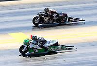 Sep 14, 2013; Charlotte, NC, USA; NHRA pro stock motorcycle rider John Hall (near) races alongside Eddie Krawiec during qualifying for the Carolina Nationals at zMax Dragway. Mandatory Credit: Mark J. Rebilas-