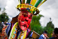 """A native from the Kamentsá tribe, wearing a colorful mask, takes part in the Carnival of Forgiveness, a traditional indigenous celebration in Sibundoy, Colombia, 12 February 2013. Clestrinye (""""Carnaval del Perdón"""") is a ritual ceremony kept for centuries in the Valley of Sibundoy in Putumayo (the Amazonian department of Colombia), a home to two closely allied indigenous groups, the Inga and Kamentsá. Although the festival has indigenous origins, the Catholic religion elements have been introduced and merged with the shamanistic tradition. Celebrating annually the collaboration, peace and unity between tribes, they believe that anyone who offended anyone may ask for forgiveness this day and all of them should grant pardons."""