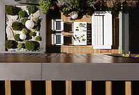 A bird's eye view of the terraced roof garden and the open-air living space