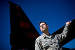 Director of operations Major Kristofer Gifford poses in front of a U2 spy plane at Beale Air Force Base in Linda, Calif., April 30, 2010.