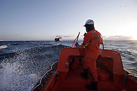 Coastguard inspectors check a Lithuanian prawn trawler. Coastguard vessel KV Svalbard patrols the northermost waters of Norway, including around the islands that she is named after. The main task is inspecting fishing boats, but she also performs search and rescue missions, and environmental monitoring. © Fredrik Naumann