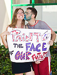 Genevieve Gilbert, (Canada) receives a kiss from Olivier James Lavoie, (Canada) during a youth action at the United Nations Climate Change Conference.(©Robert vanWaarden, Nusa Dua, Indonesia, Dec 6, 2007)