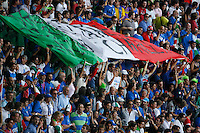 Jul 9, 2006; Berlin, GERMANY; Italy supporters unfurl a large Italian flag prior to the match between Italy and France in the final of the 2006 FIFA World Cup at the Olympiastadion, Berlin. Italy defeated France 5-3 on penalty kicks following a 1-1 draw after extra time to win the World Cup. Mandatory Credit: Ron Scheffler-US PRESSWIRE Copyright © Ron Scheffler