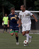 Boston College forward/midfielder Amit Aburmad (7) brings the ball forward as Quinnipiac University defender William Cavallo (24) closes. Boston College defeated Quinnipiac, 5-0, at Newton Soccer Field, September 1, 2011.