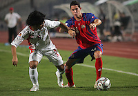 United Arab Emirates' Amer Abdulrahman (5)  battles Costa Rica's Bryan Oviedo (14) during the FIFA Under 20 World Cup Quarter-final match at the Cairo International Stadium in Cairo, Egypt, on October 10, 2009. Costa Rica won the match 1-2 in overtime play.
