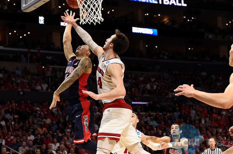 28 MAR 2015:  Frank Kaminsky (44) of the University of Wisconsin blocks the shot of Gabe York (1) of the University of Arizona during the 2015 NCAA Men's Basketball Tournament held at the Staples Center in Los Angeles, CA.  Wisconsin defeated Arizona 85-78 to advance to the Final Four.  Jamie Schwaberow/NCAA Photos