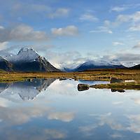 Refelction of mountains in pond, near Rolvsfjord, Vestvågøy, Lofoten islands, Norway