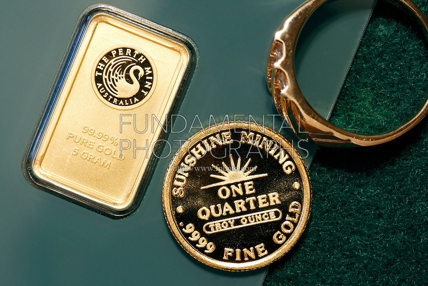 GOLD<br /> Australian Elemental Gold Bar with Coin and Ring<br /> Elemental gold bar 99.99 assay on weight, numbered. A highly sought after precious metal, gold is dense, soft, shiny and the most malleable and ductile pure metal known.