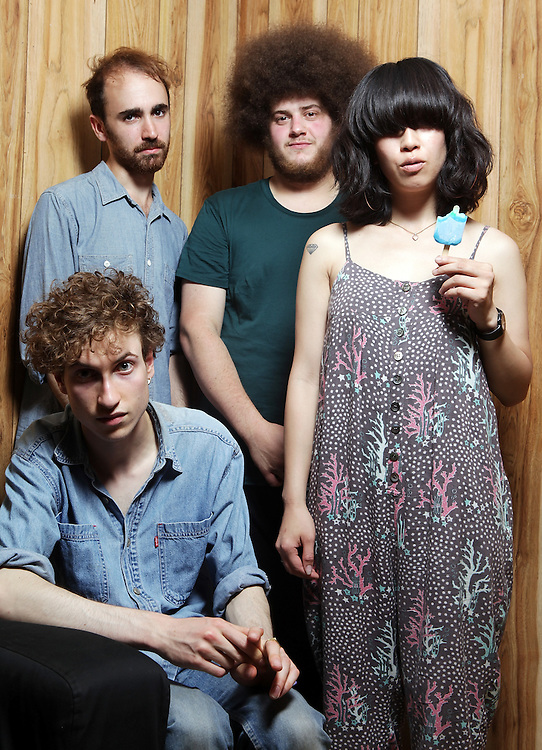 CHICAGO, IL - JULY 17:  (L-R) Daniel Blumberg, Max Bloom, Jonny Rogoff and Mariko Doi and pose for a portrait backstage during the 2011 Pitchfork Music Festival in Union Park on July 17, 2011 in Chicago, Illinois.  (Photo by Roger Kisby/Getty Images)