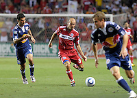 Chicago midfielder Freddie Ljungberg (8) looks to pass the ball while being defended by New York defender Rafael Marquez (4).  The Chicago Fire tied the New York Red Bulls 0-0 at Toyota Park in Bridgeview, IL on August 8, 2010