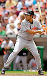 21 May 2006: Bruce Chen, pitcher for the Baltimore Orioles, at bat during a game against the Washington Nationals at RFK Stadium in Washington, DC. The Nationals defeated the Orioles 3-1 to take 2 of 3 games in their first inter-league series...Mandatory Photo Credit: Ed Wolfstein Photo..