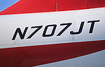 "Personalized number plate of John Travolta's jumbo jet. N707JT...John Travolta is pilot of his very own jumbo jet, a 1964 Boeing 707-100 series. In 2003, John Travolta flew his jumbo jet around the world, in partnership with Quantas, to rekindle confidence in commercial aviation, and to remind us that elegance and style are a part of flying. The crew are dressed in tailor made authentic uniforms from the Quantas museum. The men's uniforms are styled on British Naval uniforms and the ladies' designed by Chanel. His jumbo jet sports a personalised number plate N707JT which speaks for itself. The aircraft is named ""Jett Clipper Ella"" dedicated to his son and daughter. This jumbo together with his other aircraft are housed in purpose built hangars at his home in Florida, USA."