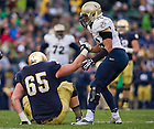Nov. 2, 2013; Offensive guard Conor Hanratty (65) is helped up by Navy linebacker Chris Johnson (46).<br /> <br /> Photo by Matt Cashore