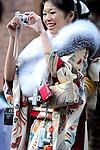 A kimono-clad 20-year-old Japanese woman plays cameraman for her friends during a ceremony held for Coming-of-Age Day at Toshimaen amusement park in Tokyo, Japan on 14 January 2008. While Japanese women can marry as early as 16 years of age and men at 18, neither is considered to reach adulthood until they reach 20, when they can also legally begin to smoke, drink and vote.COMING OF AGE