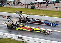 Sep 25, 2016; Madison, IL, USA; NHRA top fuel driver J.R. Todd (near) defeats Pat Dakin during the Midwest Nationals at Gateway Motorsports Park. Mandatory Credit: Mark J. Rebilas-USA TODAY Sports