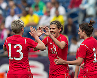Canadian midfielder Christine Sinclair (12) celebrates her goal with teammates. In an international friendly, Canada defeated Brasil, 2-1, at Gillette Stadium on March 24, 2012.