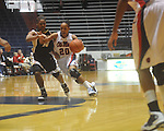 "Mississippi's Kayla Melson (20) dribbles past Vanderbilt's Christiana Foggie (10) at the C.M. ""Tad"" Smith Coliseum in Oxford, Miss. on Sunday, January 2, 2011. Mississippi won 72-67. (AP Photo/Oxford Eagle, Bruce Newman)"